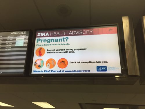 At Fort Lauderdale, Zika virus information is on display screens, right nex to the flight information screens_courtesy FLL Airport